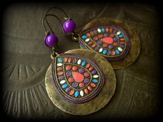 gorgeous Aged brass hoops finished with overlaying enameled brass drops with lavender leather framing. Im in love!!! these earrings ROCK!! finished