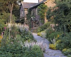 The old-fashioned house and garden at Hill Top Farm, Beatrix Potter's home in the English Lake District
