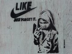 Graffiti about child labour and child soldiers by Deadboy, Toronto 2012