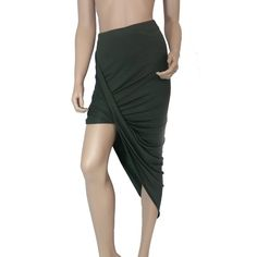 Olive Asymmetrical Draped Skirt #008-O Olive Stretchy fabric that is higher on one side and drapes across. 95% rayon 5% spandex. Stretchy material, elastic waist. Measurements: waist 30-32 Trend Theology Skirts