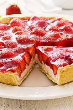Recipe including course(s): Dessert; and ingredients: almond extract, corn starch, cream cheese, heavy cream, lemon juice, pie crust, powdered sugar, strawberries, sugar, syrup, vanilla extract, water