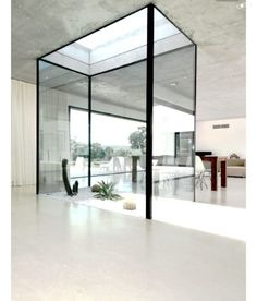 """A stunning architectural light well which doubles as an internal courtyard. A sculpture could look beautiful in this space and also act as a """"live"""" piece of artwork #lightwell #internal #courtyard #natural #light #love #luxe #art #minimalist #modern #interiors #interiordesign #design #decor #architecture by bespokeinteriordesign"""