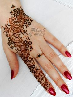 Pretty henna... Check out more desings at: http://www.mehndiequalshenna.com/