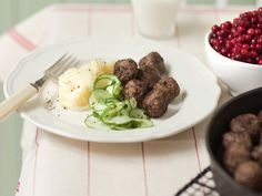 Meatballs with mashed potatoes, pickled cucumber and lingonberries.