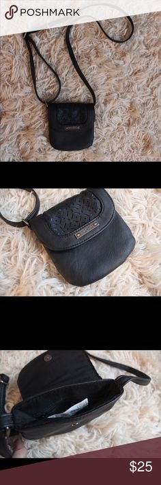 Rip Curl Mini Black Crossbody Bag w/ Blue Detail Perfect going out Mini crossbody bag from Rip Curl with adjustable strap. Black with blue detailing under the front flap with a zipper enclosure on the inside. Style with any bohemian dress and sandals, or a from form fitting clubbing dress.  🔸Great condition. Like new. 🔸100% Polyurethane  🔸See picture with hand for size. 🔸 No trades. 🔸Make me an offer! Rip Curl Bags Mini Bags