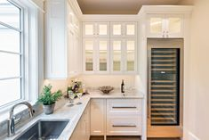 A pantry shot from our Osterville renovation with a wine fridge. Holds 750 bottles, that should be enough for the long weekend 😜🍷 . Custom Kitchens, Interior Decorating, Interior Design, Custom Cabinetry, Bath Design, Kitchen And Bath, Built Ins, Kitchen Cabinets, Wine Cabinets