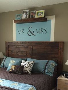 Reclaimed wood king headboard - just slightly adapted from: http://ana-white.com/2010/03/plans-reclaimed-wood-look-headboard-king-size.html  Vinyl wall decal from Uppercase Living.