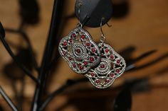 Stainless steel earings with red stones great for everyday wear with no color change and long resistance. Now on SALE for $15 and FREE SMALL GIFT BAG with purchase.