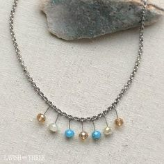 A delicate chunky silver chain short necklace with blue and cream crystal beads.  One of a kind, designed by Lavish Three. Would make a great Valentine's or Mothers day gift for her! Check out our exclusive line of unique one of kind necklaces and bracelets.