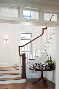 Check out this stairway. Wow, I like the window on the back wall. I think the beadboard looks beachy and I love the transoms that makes the stairway into a separate room, but lets light in at the same time. White Staircase, Staircase Design, Staircase Landing, Staircase Ideas, Grand Staircase, White Wood Paneling, Paneling Walls, Painting Paneling, Tongue And Groove Panelling
