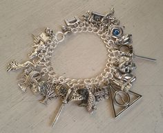 Hey, I found this really awesome Etsy listing at http://www.etsy.com/listing/156738273/ultimate-harry-potter-charm-bracelet