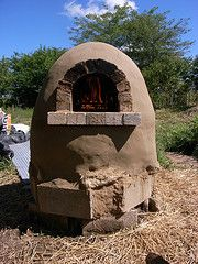 Build Your Own $20 Outdoor Cob Oven for Great Bread and Pizza    Earth ovens take a long time to heat up.  That's why they used to have village bakers and everyone brought their own loaves to be baked in the oven.  They would put their own distinctive slashes on top so they could identify them.