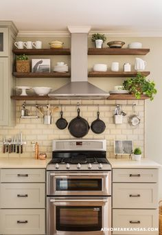 I love how the shelves work around stove hood. Also how the back splash stops at the shelves.