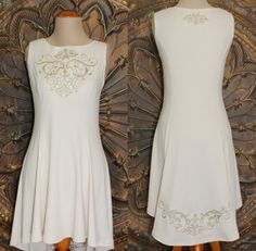 Ivory Sleeveless Embroidered Tunic Top