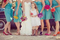 good idea: each girl has a solid color bouquet with matching shoes and the brides bouquet is a mix of them all