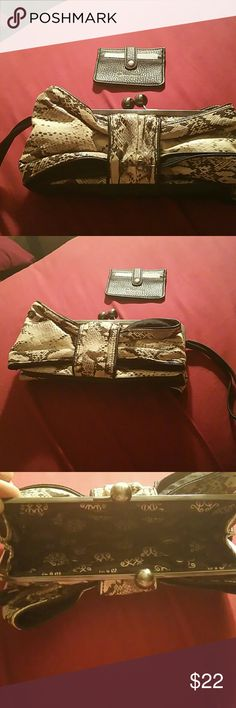 NWOT Jessica Simpson Wristlet NWOT Jessica Snake print wristlet with card holder. Great for a print lover or a simple night out! Jessica Simpson  Bags Clutches & Wristlets