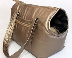 This luscious gold leather dog carrier/purse is made of lush, butter-soft gold leather and will provide your baby with the ultimate in comfort and you with a stylish look!. The interior is a snugly long pile tiger faux fur (other fur lining options available) that makes a comfy bed for your baby. There is a removable ultra-soft matching tiger faux fur pillow which can be removed while out or at home for a super-soft bed. There is a scoop opening for the head as well as a mesh window to…