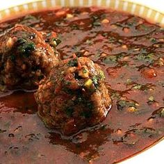 Kibbeh bi'kizabrath (cilantro-tomato soup with Syrian meatballs) from See full recipe on:LA TimesLA Times, found @Edamam!