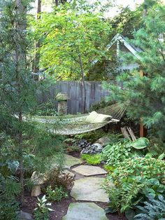 Get a Room. If you don't want to work on making your entire yard a private paradise, take one corner and transform it into a secluded getaway. A simple way to do this is to carefully place a couple of trees to form a pocket. Here, for example, two pines make a hammock feel tucked away. A redbud just behind the hammock enhances the effort.