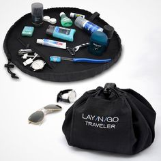 "The Lay-n-Go Traveler is a 20"" diameter men's Dopp Kit that converts into an easily transportable handled pack, allowing for quick and effortless clean-up of toiletries and bath basics. Men's essentials stored in the Lay-n-Go, are easily spread out on a clean, contained, dry surface--there is also an added pocket to the inside for small items. No more digging through your toiletry bag or putting your toothbrush on a hotel counter. Once finished, pull the drawstring and the kit is converted…"