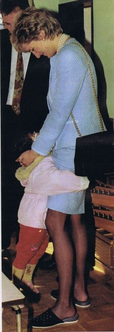 Princess Diana.   Note her shoes. http://31.media.tumblr.com/51fe40b17ba054da37086c1df08b3648/tumblr_mu6eawJ5xP1s6wm8mo3_1280.jpg