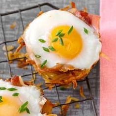 """Wow your brunch guests with this adorable muffin-tin recipe of baked eggs in a """"nest"""" of prosciutto and hash browns."""