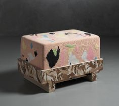 """Foot stool""""Particle"""" foot stool by Bethan Laura Wood. Laminate marquetry and MDF base, upholstered seating, fabric cover. UK, 2013"""