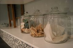 I like the idea of putting detergent, dryer sheets, etc. in glass jars.