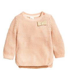 Powder. Textured-knit sweater in a soft cotton blend with a button on one shoulder. Slits at sides.