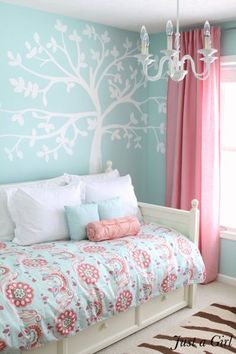 Dreamy daybed corner with mini chandelier and walls in robin egg blue. The tree mural is DIY.