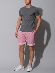 Pair a charcoal crew-neck tee with pink shorts for a comfortable outfit that's also put together nicely. Opt for a pair of white plimsolls to show your sartorial savvy. Shop this look on Lookastic: https://lookastic.com/men/looks/charcoal-crew-neck-t-shirt-pink-shorts-white-plimsolls/2632 — Charcoal Crew-neck T-shirt — Pink Shorts — White Plimsolls