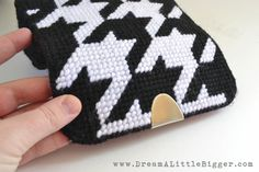 This plastic canvas clutch tutorial is easy to follow and makes a super cute bag just to your style for around SIX bucks. How cool is that?
