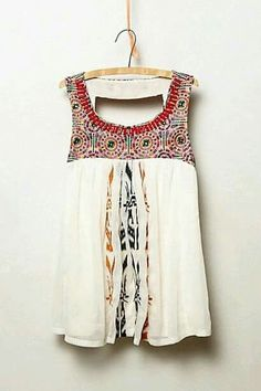 I think this would look great with skinny jeans. Airy, flowy, cool - with arms and chest open. I like prints and touch of beading, just not sure about these in particular.
