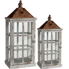 You'll get two of these fantastic lanterns with your purchase! This rustic looking pair of candle holders feature wood frames, tin tops, and glass panels. Place candles or any other decor inside. These