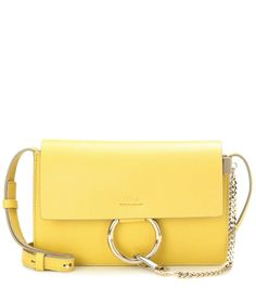 Chloé - Faye Small leather shoulder bag - In grainy yellow leather, this timeless design features a smooth leather flap to the front and is accented with a silver-tone loop and chain detail. - @ www.mytheresa.com