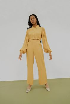 Obsessing over this Hannah Kristina Metz mustard cropped button up blouse. With full bell sleeves and tonal velvet lattice detailing on the cuffs, it is the fancy blouse your wardrobe is missing.