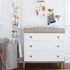 The Land of Nod's Wrightwood Collection has made it easier than ever to create the right look for any room in your home.  The Changing Table features a two-tone look of white and grey.  This two-tone construction allows the collection to coordinate with one other, while still making each individual piece stand out on its own.