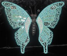 Mosaic Butterfly steel with turquoise and silver glass