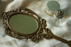 Someday when I have a vintage (or vintage-looking) vanity desk in my bedroom, I'll make sure to have a beautiful vintage hand mirror to go with it.