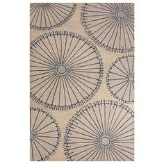 Jaipur's National Geographic Home Organism rug draws inspiration by fossils and other natural finds. This layer stuns with a large-scale scheme of sea urchin-like silhouettes, sophisticated in gray and blue tones. The hand-tufted wool construction offers unrivaled softness, ideal in a family room or contemporary dining space. 2'W x 3'L. 5'W x 8'L. 8'W x 10'L. Fog & Ensign Blue. Colors noted are Pantone TPX. 100% wool. Vacuum regularly; professional cleaning recommended.