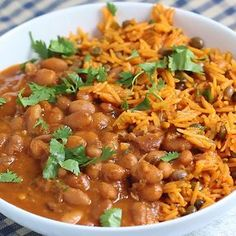 Mom's authentic Puerto Rican Rice and Beans with savory homemade sofrito and sazon! You'll love this incredibly flavorful, comforting homemade meal that will fill your home with unbelievably delicious smells. The perfect recipe to serve a crowd or just savor leftovers for a few days!