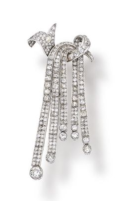 An art deco diamond brooch, circa 1920 designed as an old-cut diamond draped tassel; estimated total diamond weight: 10.00 carats; mounted in platinum; length: 3 1/2in.