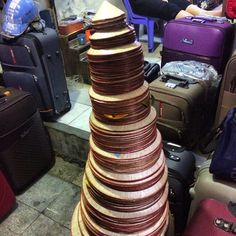 A tower of Vietnamese hats - not sure who the smallest one would fit? Lol #upsticksandgo #hats #vietnameseculture #hanoi #hanoioldquarter #Vietnam #travelgram #travelphotos #travellingtheworld #michfrost | Flickr - Photo Sharing!