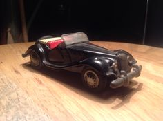 A very early MG TF from Bandai Japan.....small and nice tin toy from the 50s....excellent condition