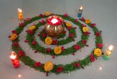 Circular flower design for Diwali with glowing candles. Rangoli Designs Flower, Rangoli Border Designs, Rangoli Ideas, Flower Rangoli, Beautiful Rangoli Designs, Diwali Decorations At Home, Festival Decorations, Flower Decorations, Wedding Decorations