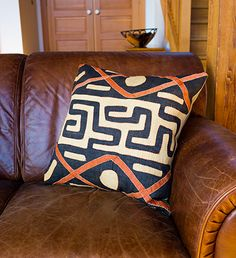 These hand-applique'd pillows add bold swaths of color to your home and are a beautiful accent to wood or leather. Fair Trade from the Congo. #designerpillows