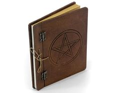 Blank Spell Book - Medium Sturdy book etched with pentacle design on a thick board cover with metal hinges and rustic twine binding Approx size - 17 x 21 x - 48 pages Journal Diary, Book Journal, Blank Book Of Shadows, Hardback Notebook, Sacred Symbols, Ways To Recycle, Skulls And Roses, Smudge Sticks, Leather Books