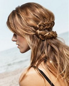 A long blonde straight coloured multi-tonal plaited hairstyle by Franck Provost