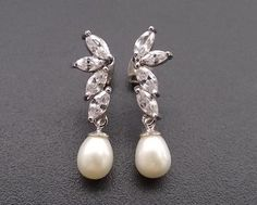 Such a classically beautiful bridal earring and will add that touch of luxurious glamour to your wedding day look with it's understated sterling silver finish. Sterling Silver Bracelets, Silver Earrings, Pearl Earrings, Wedding Earrings, Wedding Jewelry, Wedding Accessories, Hair Accessories, Silver Pearls, Ear Piercings