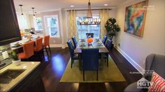 "Property Brothers -- ""Aven & Phillip"" -- LOVE this dining room. Not so much the curtains and definitely not the light, but the large table, the blue chairs, the green and even the orange accents."